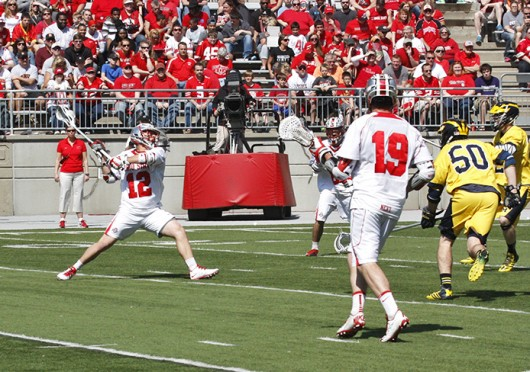Then-junior midfielder David Planning (12) takes a shot during a game against Michigan April 12 at Ohio Stadium. OSU won, 15-6. Credit: Lantern file photo