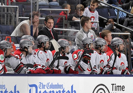 OSU hockey coach Steve Rohlik (back) talks to his team during a game against Michigan March 2 at Nationwide Arena. OSU lost, 4-3. Credit: Ben Jackson / For The Lantern