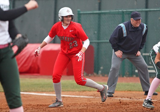 Junior outfielder Taylor Watkins (23) advances on the base path during a game against Michigan State March 22 at Buckeye Field. OSU won, 11-7. Credit: Kim Dailey / Lantern photographer