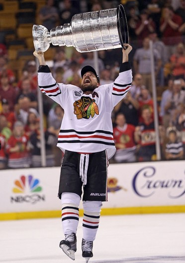 Chicago Blackhawks forward Patrick Sharp lifts the Stanley Cup after winning the trophy against the Boston Bruins June 22 at TD Bank Garden. Courtesy of MCT