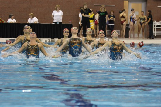 Members of the OSU Synchronized Swimming team compete during the Jessica Beck Memorial Competition Feb. 1 at McCorkle Aquatic Pavilion. The team finished 1st. Credit: Shelby Lum / Photo editor