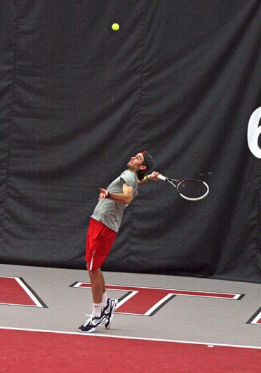Redshirt-junior Hunter Callahan serves the ball during a match against Texas A&M Feb. 9 at the Varsity Tennis Center. OSU won, 4-3. Credit: Alice Bacani / BuckeyeTV news director