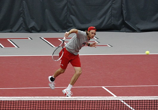 Redshirt-junior Hunter Callahan hits the ball during a match against Tulsa April 11 at the Varsity Tennis Center. OSU won, 4-3. Credit: Brian Bassett / Lantern photographer