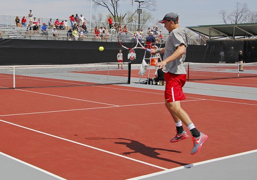 Redshirt-senior Peter Kobelt returns the ball during a match against Nebraska April 20 at the Varsity Tennis Center. OSU won, 6-1. Credit: Andrew Todd-Smith / Lantern photographer