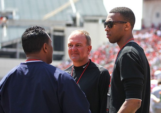 Trevor Thompson (right) talks with OSU men's basketball coach Thad Matta during the 2014 Spring Game April 12 at Ohio Stadium. Thompson announced his decision to transfer to Ohio State April 13. Credit: Shelby Lum / Photo editor