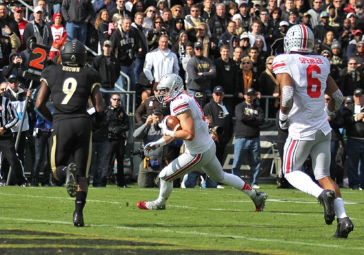 Then-redshirt-sophomore tight end Nick Vannett (81) advances the ball during a game against Purdue Nov. 2 at Ross-Ade Stadium. OSU won, 56-0. Credit: Shelby Lum / Photo editor