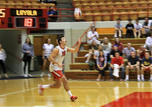 Junior middle blocker Dustan Neary runs to return a ball during a game against Loyola (Chicago)April 11at St. John Arena. OSU lost, 3-1. Credit: Logan Hickman / Lantern photographer