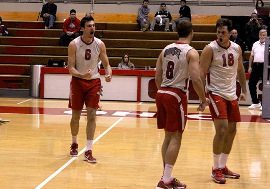 Junior outside hitter Michael Henchy (6) celebrates a point during a match against Ball State Feb. 26 at St. John Arena. OSU lost, 3-1. Credit: Kathleen Martini / Oller reporter