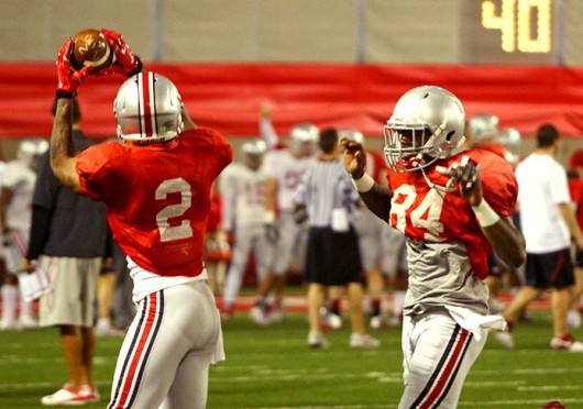 Sophomore running back Dontre Wilson (2) catches a ball during spring practice March 20 at the Woody Hayes Athletic Center. Credit: Mark Batke / For The Lantern