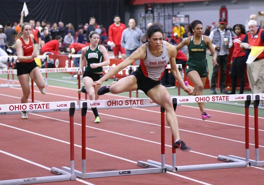 Junior sprinter and hurdler Alexandria Johnson jumps over a hurdle during the Buckeye Tune-Up Feb. 21 at French Field House. Credit: Brandon Claflin / Lantern photographer