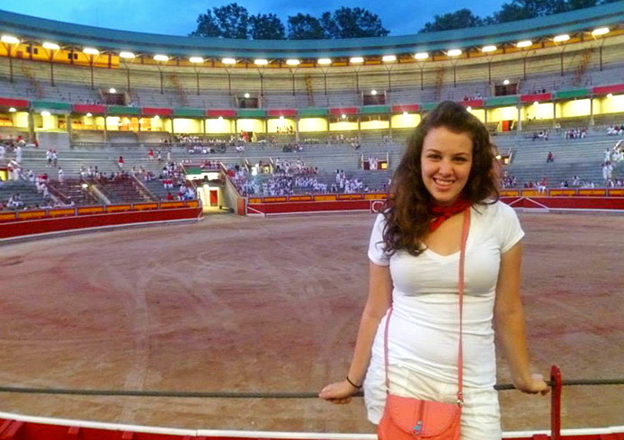 OSU student Michele Theodore stands at a bullfighting ring in Pamplona, Spain, during the annual festival of San Fermin while she studied abroad in 2013.