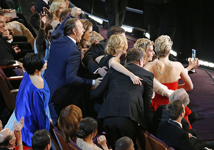 Ellen DeGeneres takes a selfie with attendees during the 86th annual Academy Awards on Sunday, March 2, 2014, at the Dolby Theatre at Hollywood & Highland Center in Los Angeles. Credit: Courtesy of MCT