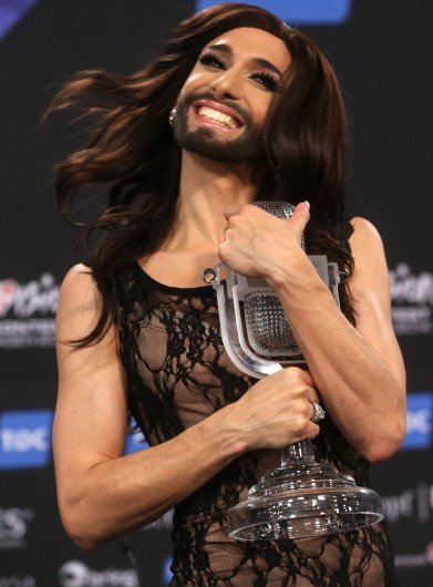 Conchita Wurst representing Austria, the winner the 2014 Eurovision Song Contest, poses for a photograph with a trophy at a press conference in Copenhagen, Denmark, May 11.  Credit: Courtesy of MCT