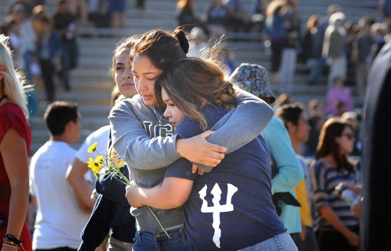 University of California at Santa Barbara students hug May 27 after a memorial service for the students who died in a shooting May 23 in Isla Vista, Calif. In the wake of the shooting, many people took to Twitter to voice their opinions on unequal treatment of women with the hashtag #YesAllWomen. Credit: Courtesy of MCT
