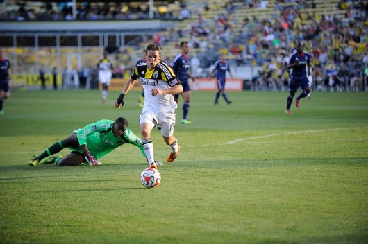 Columbus Crew midfielder Ethan Finlay dribbles past Chicago Fire goalie Sean Johnson during a game against the Fire May 24 at Crew Stadium in Columbus. The Crew won, 2-0. Credit: Courtesy of Crew Communications / Kirby Hines