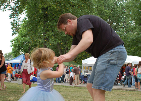 Three-year-old Maia Starr Walker and her dad Jason Walker dance to the music of Big Nasty at the 2007 ComFest in Goodale Park. Credit: Lantern file photo