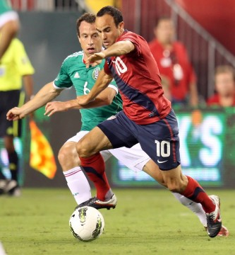 USA's Landon Donovan (10) and Mexico's Gerardo Torrado (6) compete for the ball during the first half of an international friendly at Lincoln Financial Field in Philadelphia, Pennsylvania on Wednesday, August 10, 2011. Credit: Courtesy of MCT.