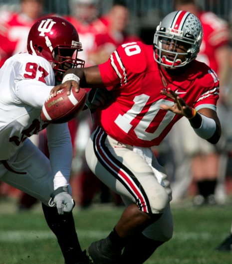 Ohio State quarterback Troy Smith (10) buys some time and eludes Indiana's Keith Burrus (97) in the second quarter of a football game, Saturday, Oct. 21, 2006 at the Ohio Stadium in Columbus, Ohio. Ohio State won the contest, 44-3. Credit: Courtesy of MCT