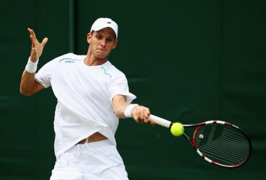 Former Ohio State tennis player Blaz Rola hits the ball in a match against Spain's Pablo Andujar June 23 at Wimbledon in Wimbledon, England. Rola won, 6-3, 6-1, 6-4. Credit: Courtesy of OSU Athletics