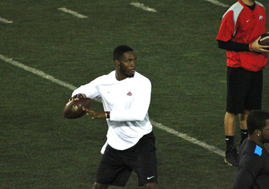 Former quarterback Kenny Guiton throws the ball during Ohio State's Pro Day March 7 at the Woody Hayes Athletic Center. Credit: Ryan Robey / For The Lantern