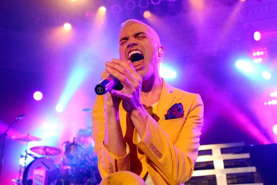 Review: Neon Trees crowd surfs and sings its way to connect with crowd