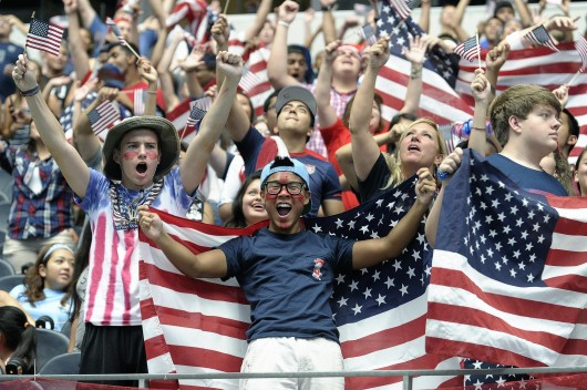 Justen Woody, left, and Robert Driskill both of Fort Worth, Texas, cheer at AT&T Stadium in Arlington, Texas, as soccer fans watch the World Cup soccer match between the USA and Belgium on July 1. Belgium advanced, 2-1, in extra time. Credit: Courtesy of MCT