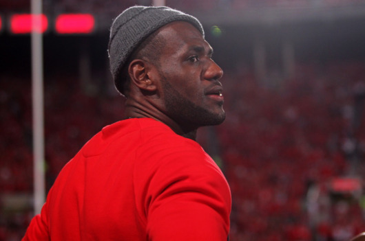 2013 NBA Champion for the Miami Heat and Akron, Ohio native LeBron James stands on the sidelines at the Wisconsin football game Sept. 28 at Ohio Stadium. OSU won, 31-24. Credit: Lantern file photo