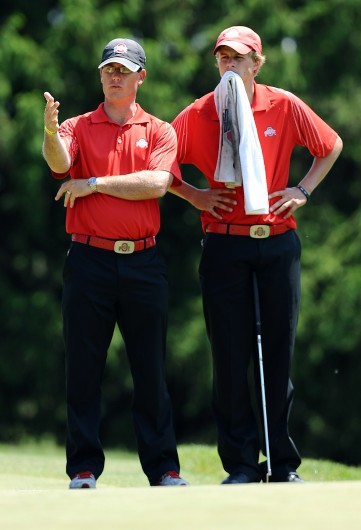 Former Ohio State assistant men's golf coach Ryan Potter (left) talks with a player during the second round of the NCAA Men's Golf Central Regional at the University of Michigan Golf Course in Ann Arbor, Mich., May 18th. Credit: Courtesy of OSU Athletics