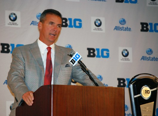 OSU football coach Urban Meyer addresses the media at the 2014 Big Ten Media Days July 28 in Chicago. Meyer was involved with one of 22 self-reported NCAA violations by OSU in the first half of 2014. Credit: Tim Moody / Lantern sports editor