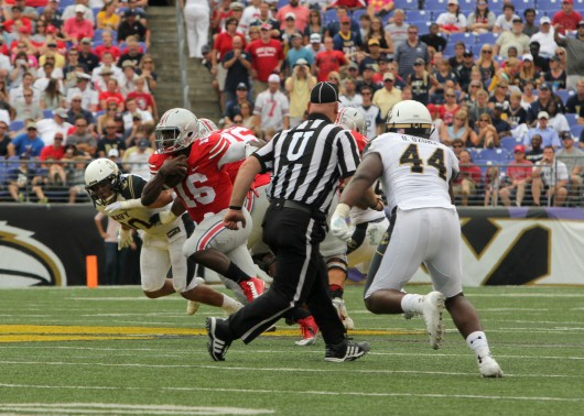 Ohio State redshirt-freshman quarterback J.T. Barrett takes off running in a game against Navy Aug. 30. OSU won 34-17. Credit: Mark Batke / photo editor