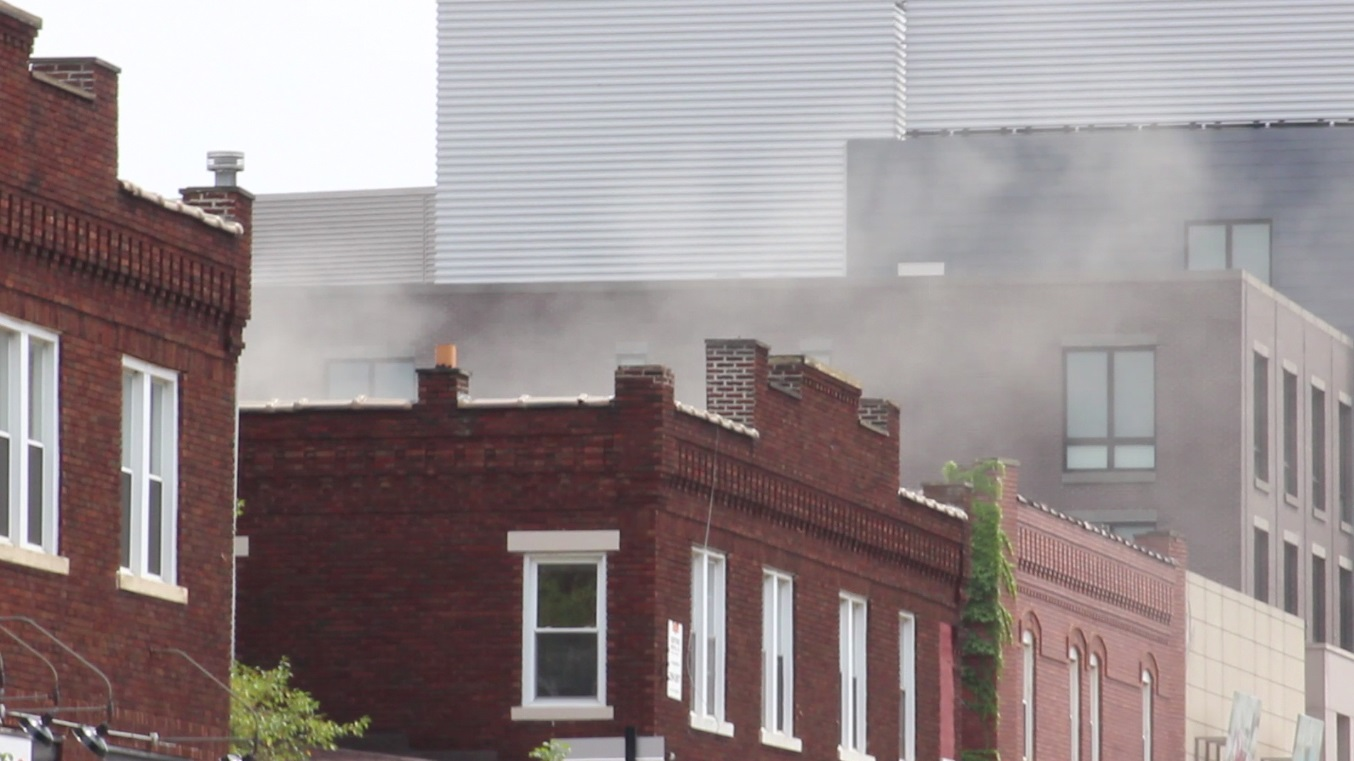 Smoke rises from Puff N' Stuff smoke shop, located at 1652 N. High St. A gas leak was reported at the smoke shop during the afternoon of Aug. 23.  Credit: Ritika Shah / Lantern TV news director