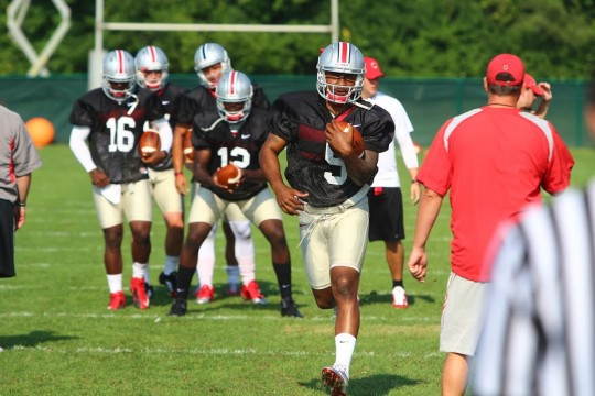 OSU senior quarterback Braxton Miller (5) carries the ball during practice at the Woody Hayes Athletic Center Aug. 9. Credit: Mark Batke / Lantern photo editor