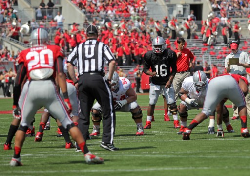 Redshirt-freshman quarterback J.T. Barrett waits for the snap during OSU's Spring Game April 12 at Ohio Stadium. Gray beat Scarlet, 17-7.  Credit: Mark Batke / Photo editor