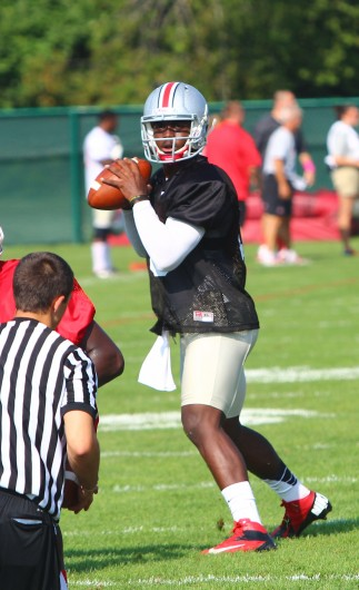 OSU redshirt-freshman quarterback J.T. Barrett scans the field during practice at the Woody Hayes Athletic Center Aug. 9.  Credit: Mark Batke / Photo editor
