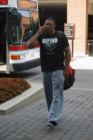 OSU junior linebacker Joshua Perry walks into the Buckeyes' team hotel, the Hyatt Place Columbus on Yard Street, Aug. 7. Credit: Tim Moody / Lantern sports editor