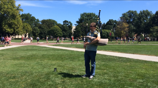 Josh Whitson, the OSU student immigration coordinator, plays the Great Highland bagpipe on the Oval Aug. 29. Credit: Liz Young / Editor-in-chief