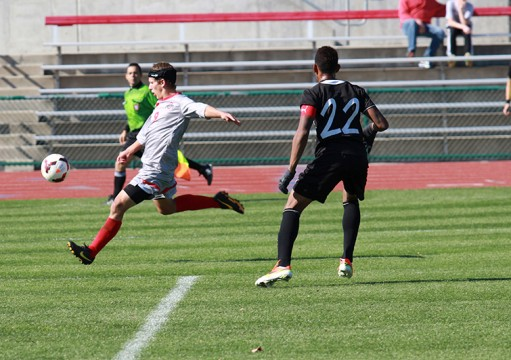 Freshman forward Danny Jensen (left) prepares for a shot during Ohio State's match against Cleveland State on Sunday, October, 27, 2013 at Jesse Owens Memorial Stadium in Columbus, Ohio. Jensen has seen playing time in all 15 matches of the 2013 season. Credit: Mart Batke / Photo editor