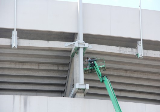 A construction worker works on a lift outside of Ohio Stadium Aug. 28.  Credit: Tim Moody / Sports editor