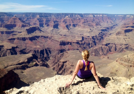 Caitlin Essig, a fourth-year in journalism, sits at the Grand Canyon this summer. Credit: Courtesy of Caitlin Essig
