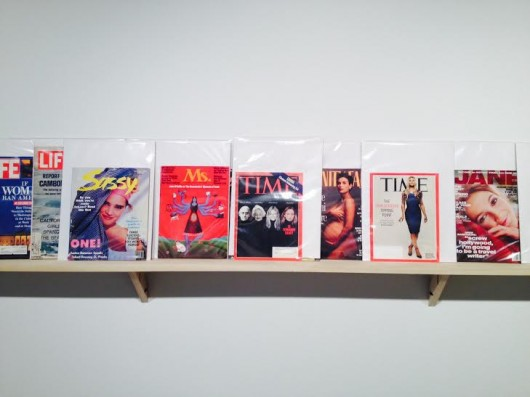 A line of magazines is displayed at 'Tracers Takes Over,' a feminist art exhibit housed in the Hopkins Hall Gallery.  Credit: Courtesy of Jennifer Reeder