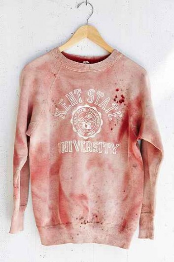 On Sept. 15, Urban Outfitters sparked controversy when a red, 'sun-faded,' vintage crewneck sweatshirt sporting the Kent State University logo was up for sale on the popular clothing store's website. The sweatshirt's blood color and bullet-like holes on the left shoulder drew connections to the May 4, 1970 shooting of four students on Kent's campus, also known as the Kent State massacre. The store pulled the sweatshirt from its site.  Credit: Screenshot from Urban Outfitters website