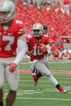 OSU redshirt-freshman quarterback J.T. Barrett runs the ball during a game against Kent State on Sept. 13 at Ohio Stadium. Barrett passed for 312 yards and 6 touchdowns in OSU's 66-0 win. Credit: Mark Batke / Photo editor