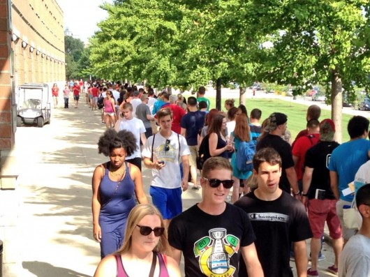 Students wait in line outside the Schottenstein Center to pick up season football tickets.  Credit: Hayden Grove / Sports director at Lantern TV