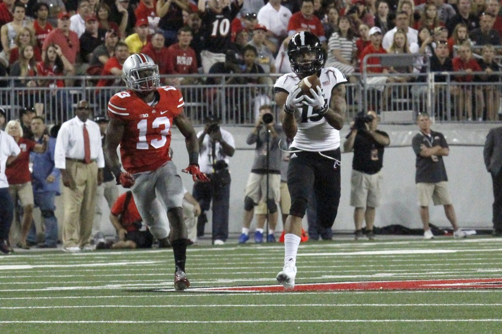 Cincinnati junior wide receiver Chris Moore runs away from OSU redshirt-freshman cornerback Eli Apple after making a catch during a game on Sept. 27 at Ohio Stadium. OSU won, 50-28, despite Moore's 221 yards and three touchdowns through the air. Credit: Jon McAllister / Asst. photo editor