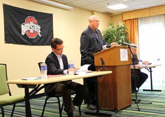 From left: TBDBITL Alumni Club president Brian Golden, director emeritus Paul Droste and law chair Gary Leppla oversee a meeting at the Fairfield Inn on Olentangy River Road on Sept. 12. The meeting dealt heavily with the association's newly published report on the firing of former band director Jonathan Waters.  Credit: Lee McClory / Design editor
