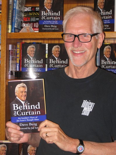 """Dave Berg holds his book, 'Behind the Curtain: An Insider's View of Jay Leno's """"Tonight Show.""""' Credit: Courtesy of Mary Berg"""