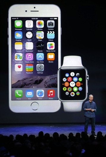 Apple CEO Tim Cook introduces the iPhone 6 and the Apple smartwatch at the Flint Center on Sept. 9 in Cupertino, Calif. Credit: Courtesy of MCT