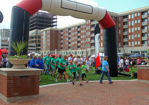 Participants of Walk to Defeat ALS make their way around Columbus Commons on Sept. 21. More than 2,000 students, patients, family and community members walked more than a mile to raise awareness and provide funding for ALS research.
