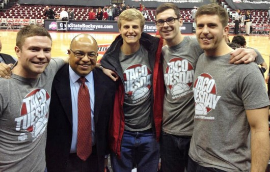 From left: Michael Duffy, ESPN analyst Mike Tirico, Logan Jones, Jake Johnson and Greg Greve pose before an OSU basketball game against Michigan on Feb. 11 at the Schottenstein Center. Credit: Courtesy of Jake Johnson