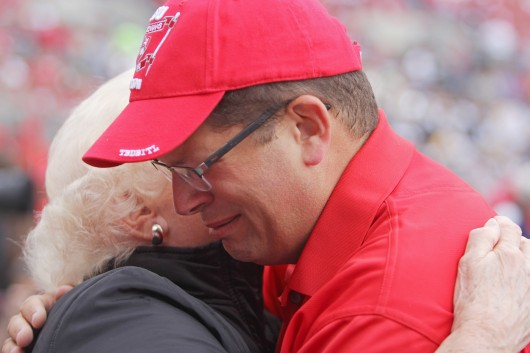 Former OSU Marching Band director Jonathan Waters tears up after the halftime show against Kent State on Sept. 13 at Ohio Stadium. Waters directed the alumni band at points throughout the game but did not march in the halftime show. Credit: Chelsea Spears / Multimedia editor